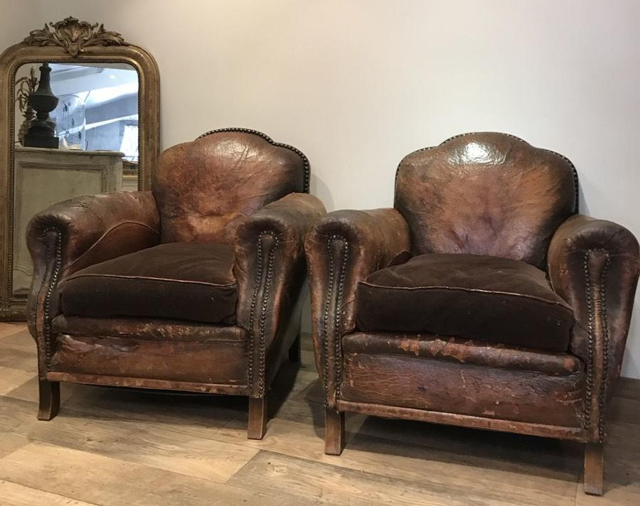 PAIR OF STUDDED LEATHER ARMCHAIRS