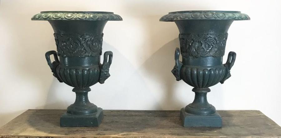 ANTIQUE CAST IRON URNS