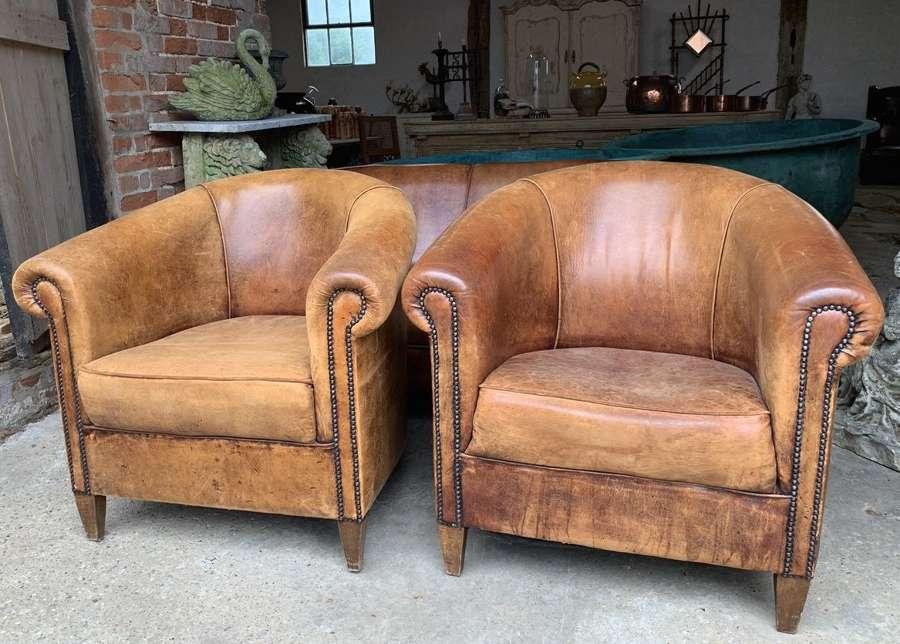 PAIR OF VINTAGE LEATHER TUB CHAIRS