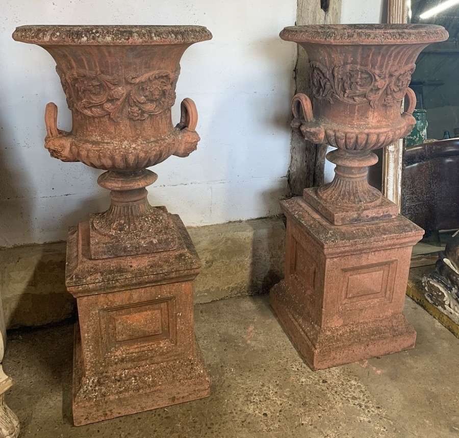 PAIR OF LARGE GARDEN URNS ON PLINTHS